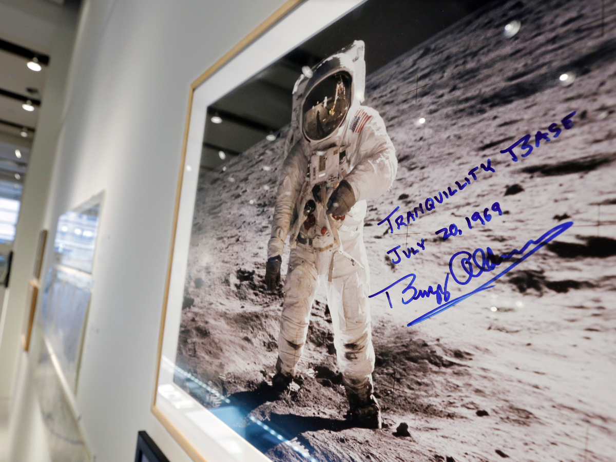 A print of astronaut Neil Armstrong's photograph of fellow Apollo 11 astronaut 'Buzz' Aldrin standing on the moon, to be offered at auction at Sotheby's, is displayed in New York, Thursday, July 13, 2017. The photo, autographed by Aldrin, is estimated at $2,500 to $3,500. (AP Photo/Richard Drew).
