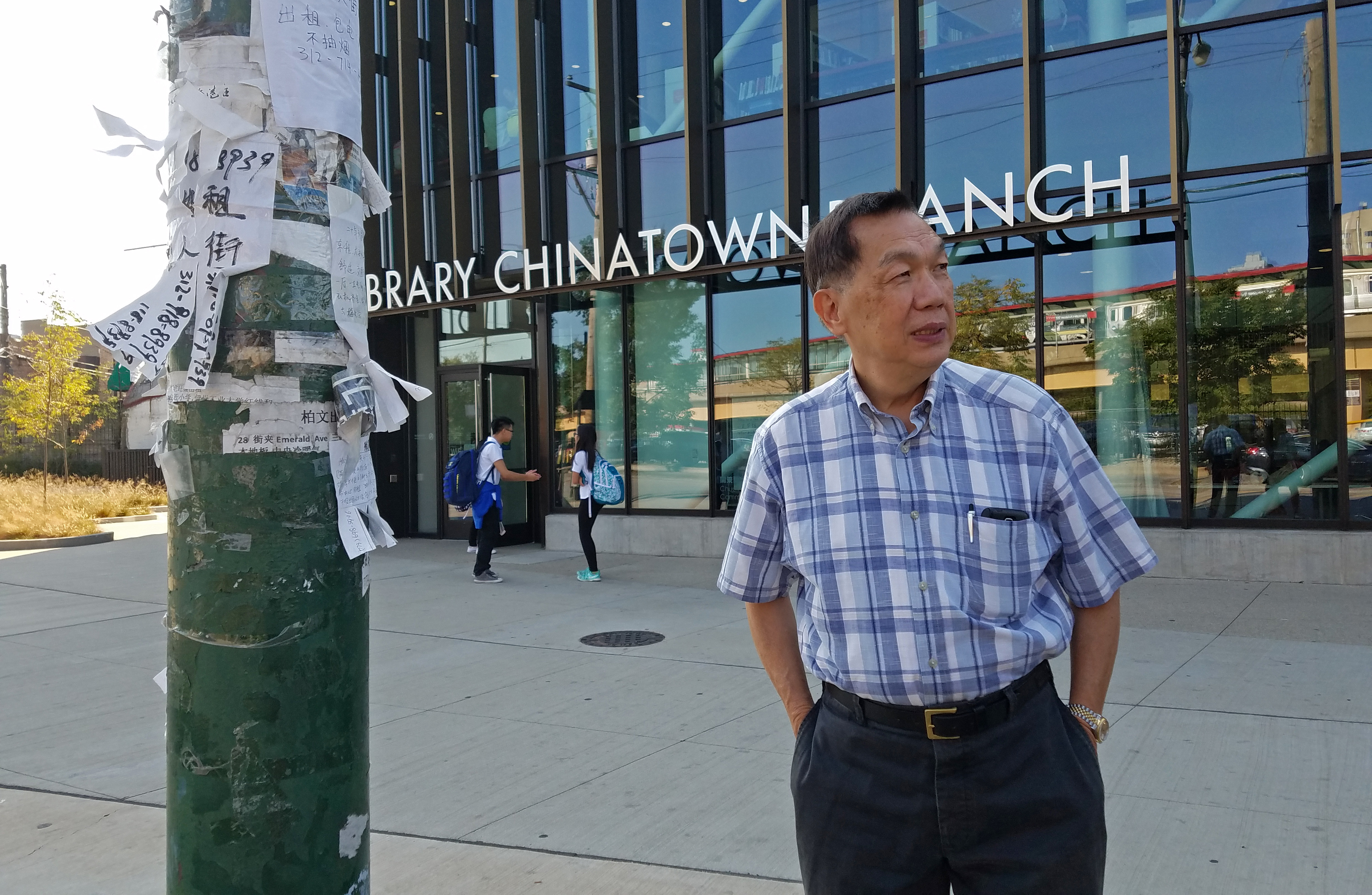 C.W. Chan stands in front of the new Chinatown branch library, one of several development projects that have made Chinatown an attractive neighborhood to non-Chinese Chicagoans. (WBEZ/Monica Eng)