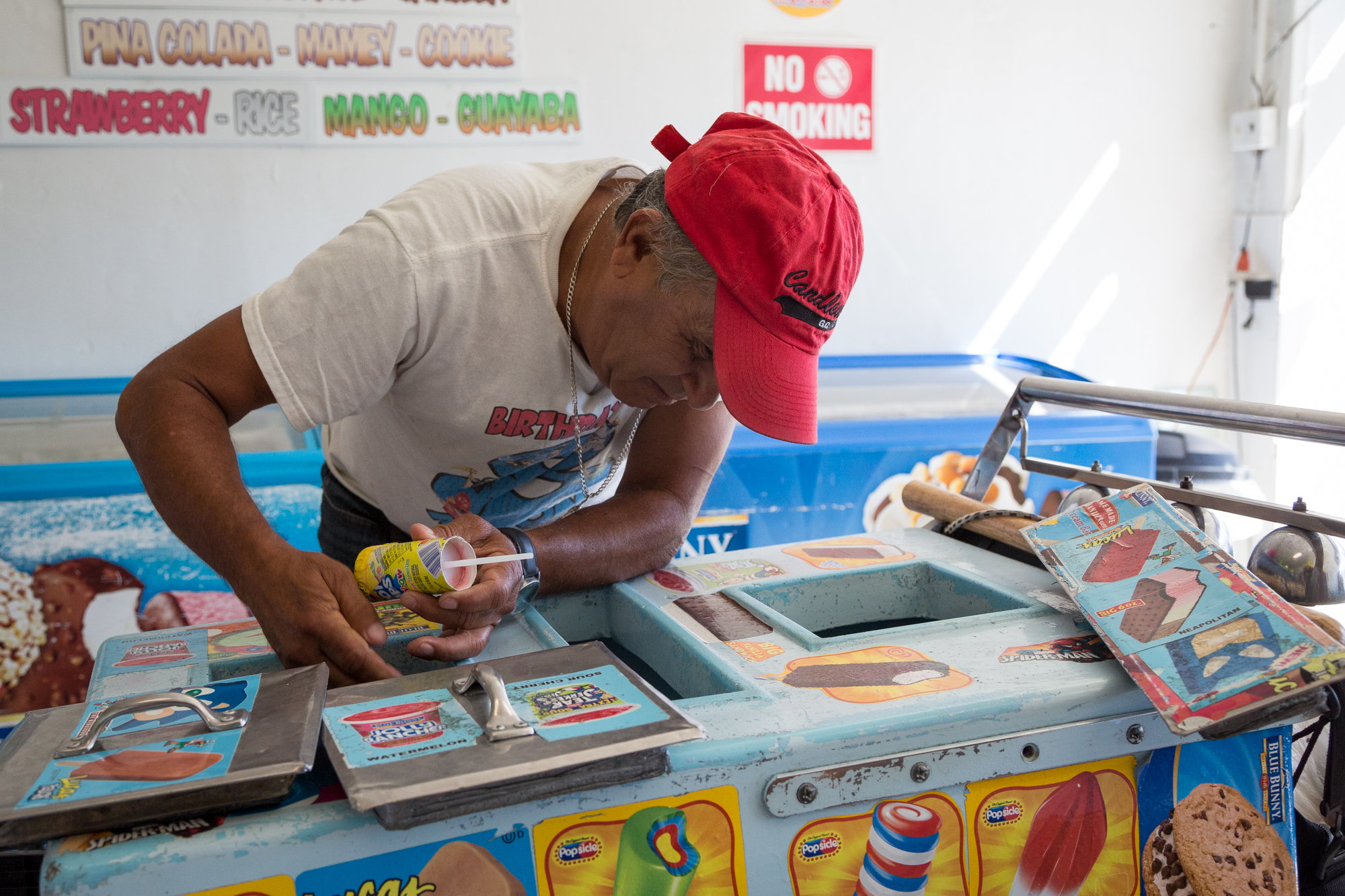 Paletero Victor Cruz can pack hundreds of paletas, ice cream bars and other frozen treats into a paleta cart at La Polar, a paleteria in Chicago's Rogers Park neighborhood. (WBEZ/Shawn Allee)