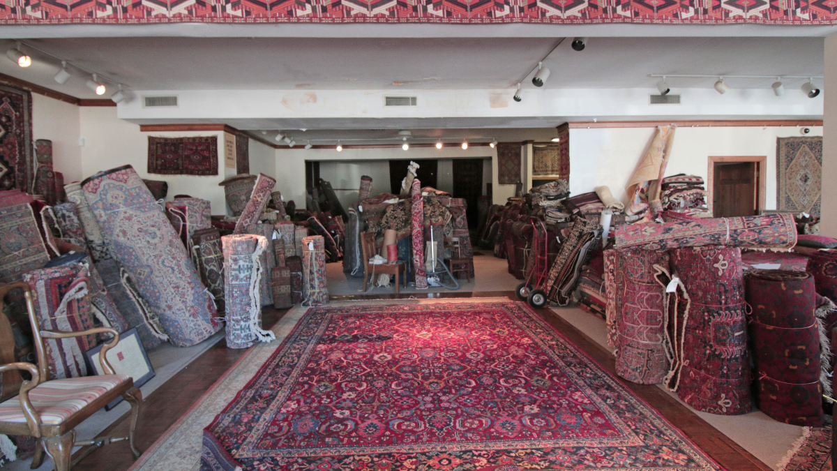 Connoisseur Oriental Rugs, located in Evanston on Chicago Avenue, has been in business for over 30 years and specializing in antique Persian rugs inspired by designs found in nature – from beetles to deer to floral patterns. (WBEZ/Katherine Nagasawa)