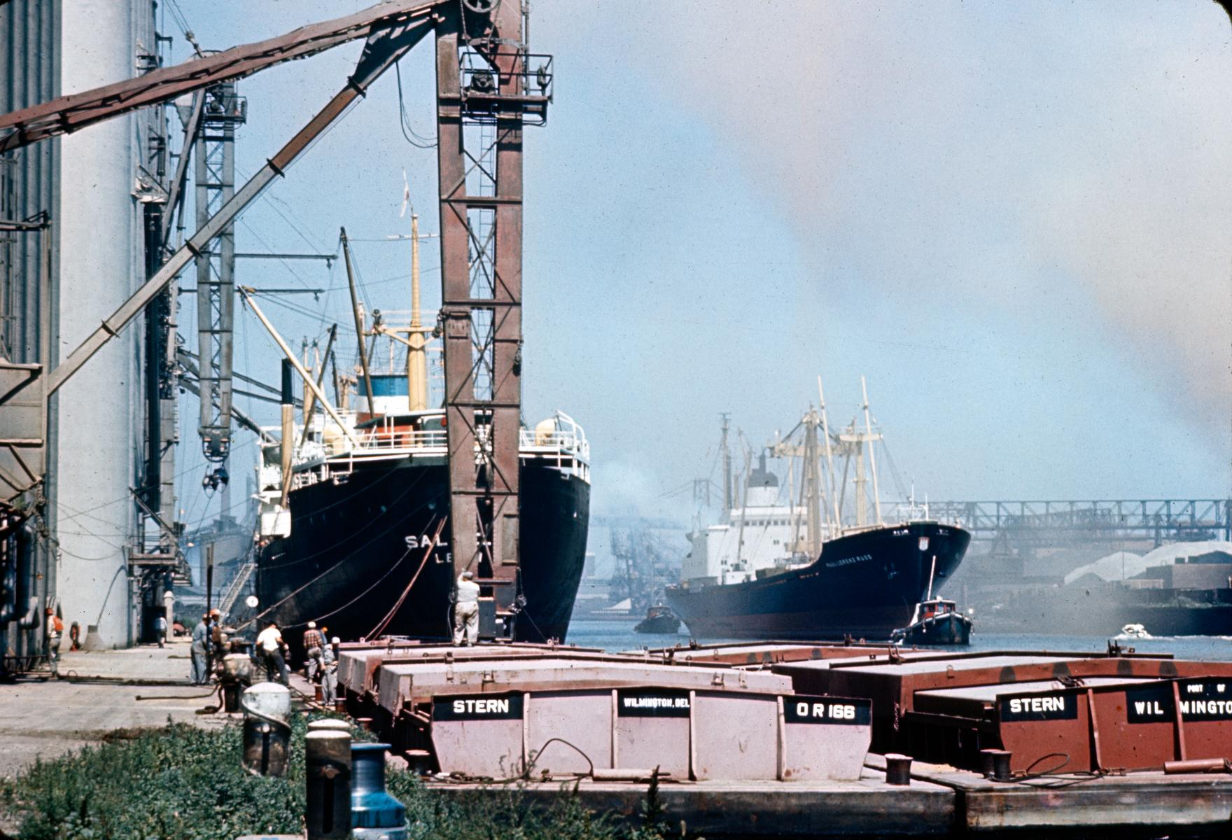 Barges, ships, loading docks and cargo-handling facilities at the Port of Chicago in 1969, during the heyday of Great Lakes shipping. (Courtesy C. William Brubaker Collection, bru012_10_dF, Special Collections, University of Illinois at Chicago Library)