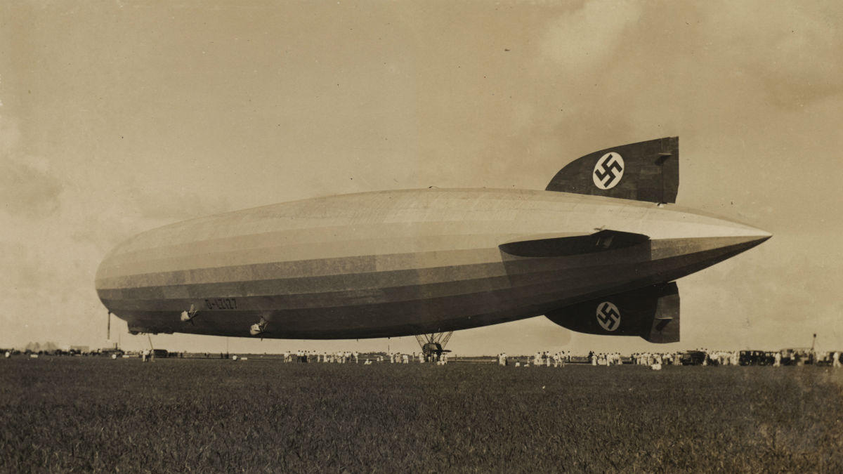 The Graf Zeppelin pictured in Opa-locka, Florida, in 1933 en route from Rio de Janeiro to Chicago. The pilot, Hugo Eckener, tried to maneuver the airship such that the swastika on its tail wouldn't be seen. (Courtesy HistoryMiami Archives & Research Center)
