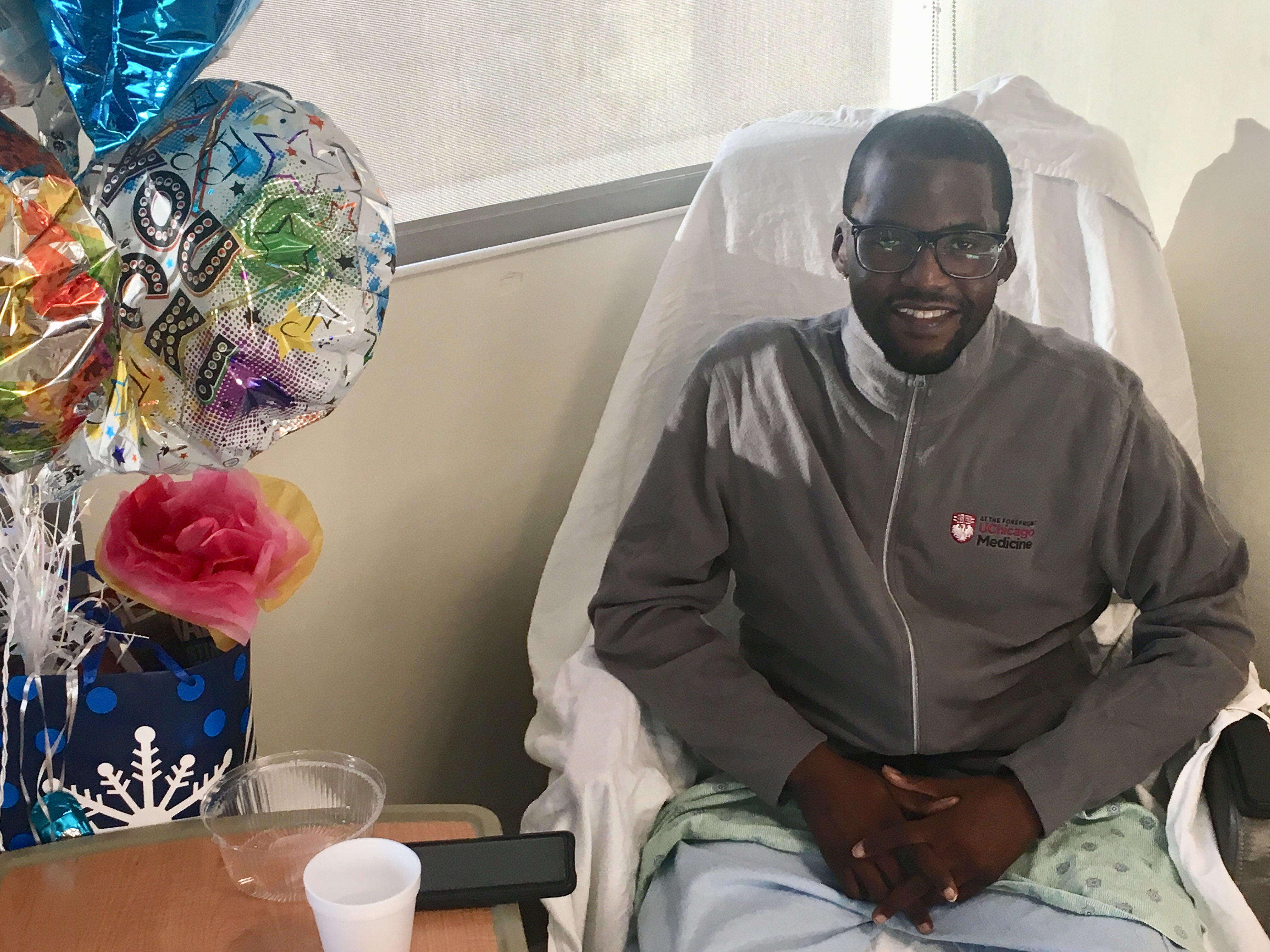 Daru Smith, 29, of Chicago resting in his hospital room several weeks after undergoing a rare triple organ transplant. (Photo by Michael Puente, WBEZ)