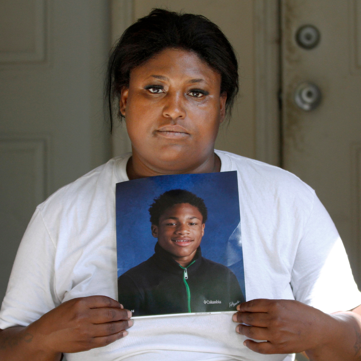 Monique Causey holds a portrait of her 14-year-old Malik, who was shot on Aug. 21, 2016, at her home in Chicago. August was the deadliest month for Chicago homicides in two decades. AP Photo/Tae-Gyun Kim.