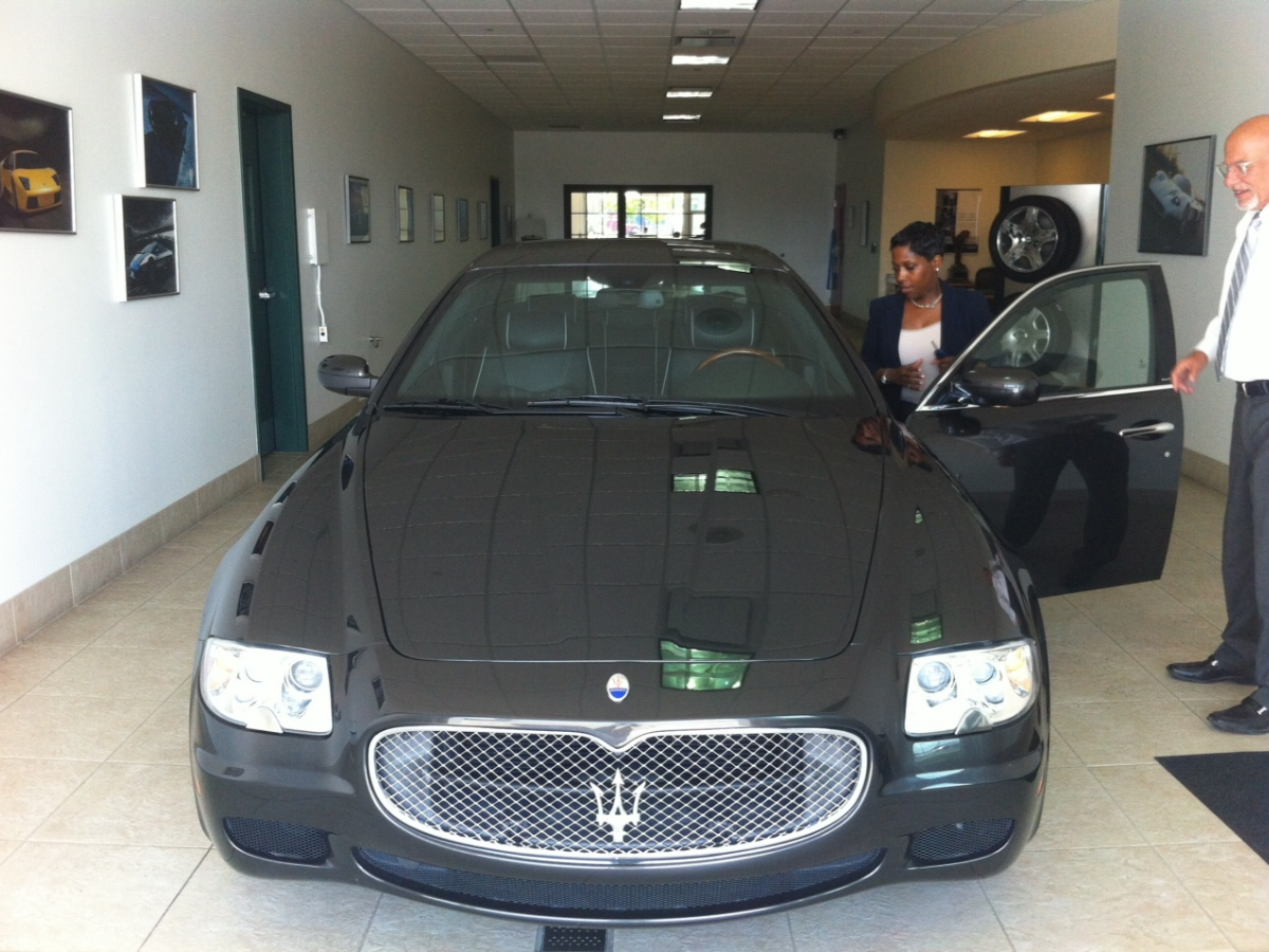 KC Wilbourn getting into a Maserati. (Courtesy of KC Wilbourn)