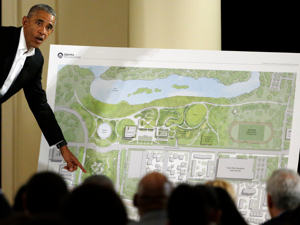 Former President Barack Obama points to a rendering of the future Barack Obama Presidential Center at the South Shore Cultural Center in Chicago in May 2017.