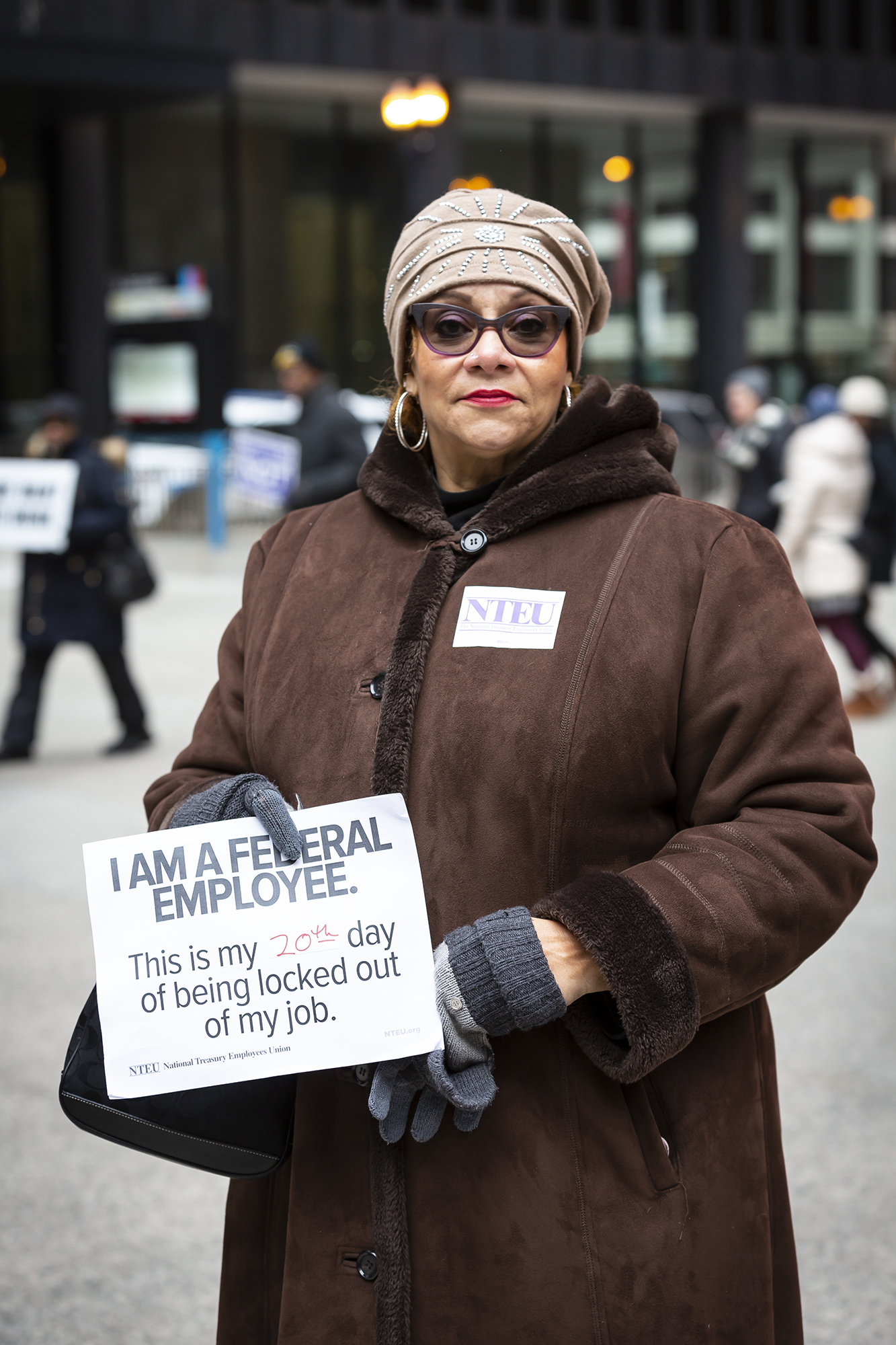 Florence Cannon, who worked at the U.S. Department of Agriculture, said she came downtown not just to rally against the shutdown, but also to clear her credit union bank account of its savings. She said she's not sure how she'll be able to continue feeding her pit bull, a rescue dog she adopted in July, without income. (Manuel Martinez/WBEZ)