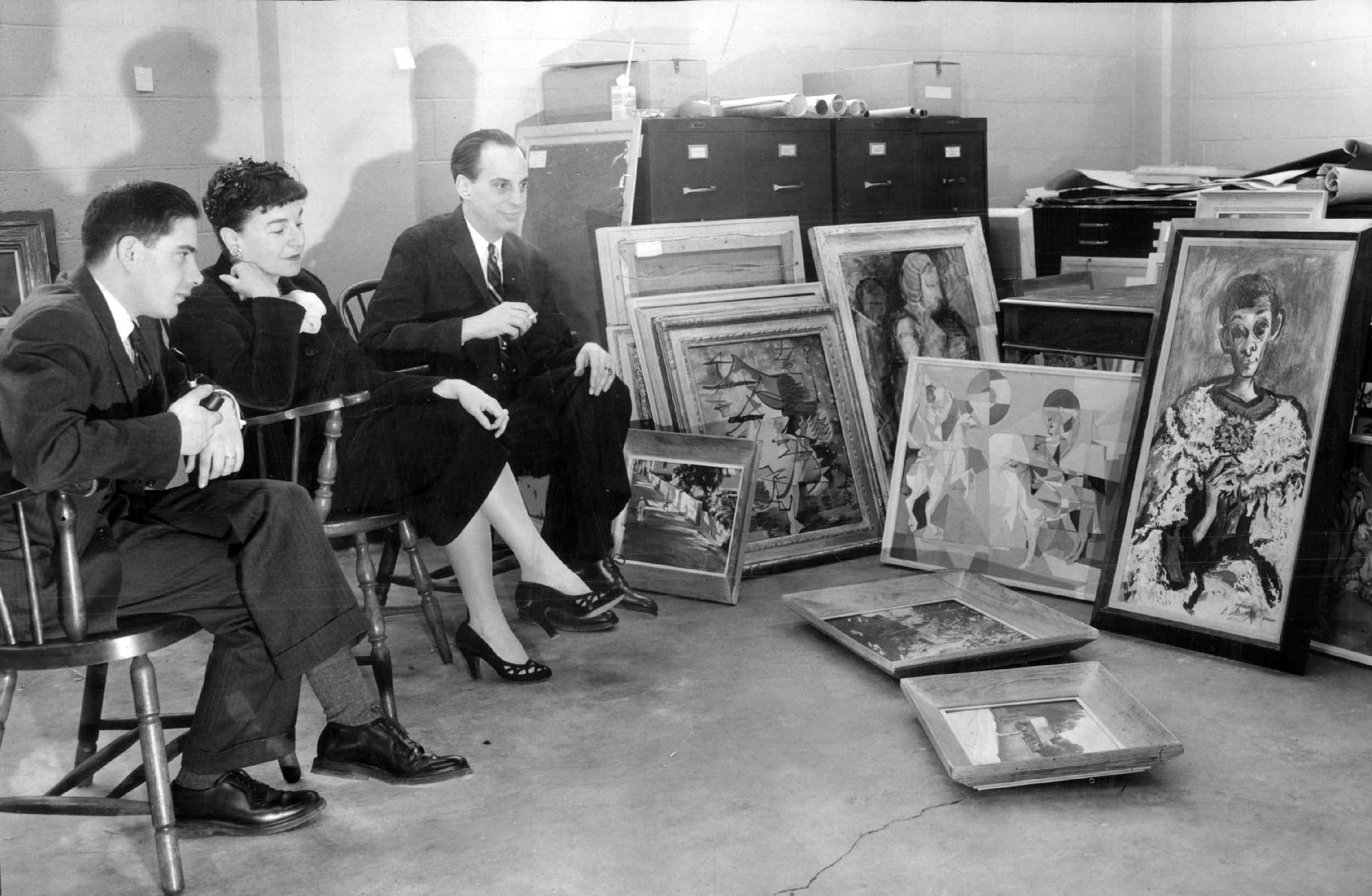 A jury of art experts deliberates on which paintings to show at a Spring exhibition for the Art Institute's Art Rental and Sales Gallery in 1959. (Courtesy Chicago Sun Times)
