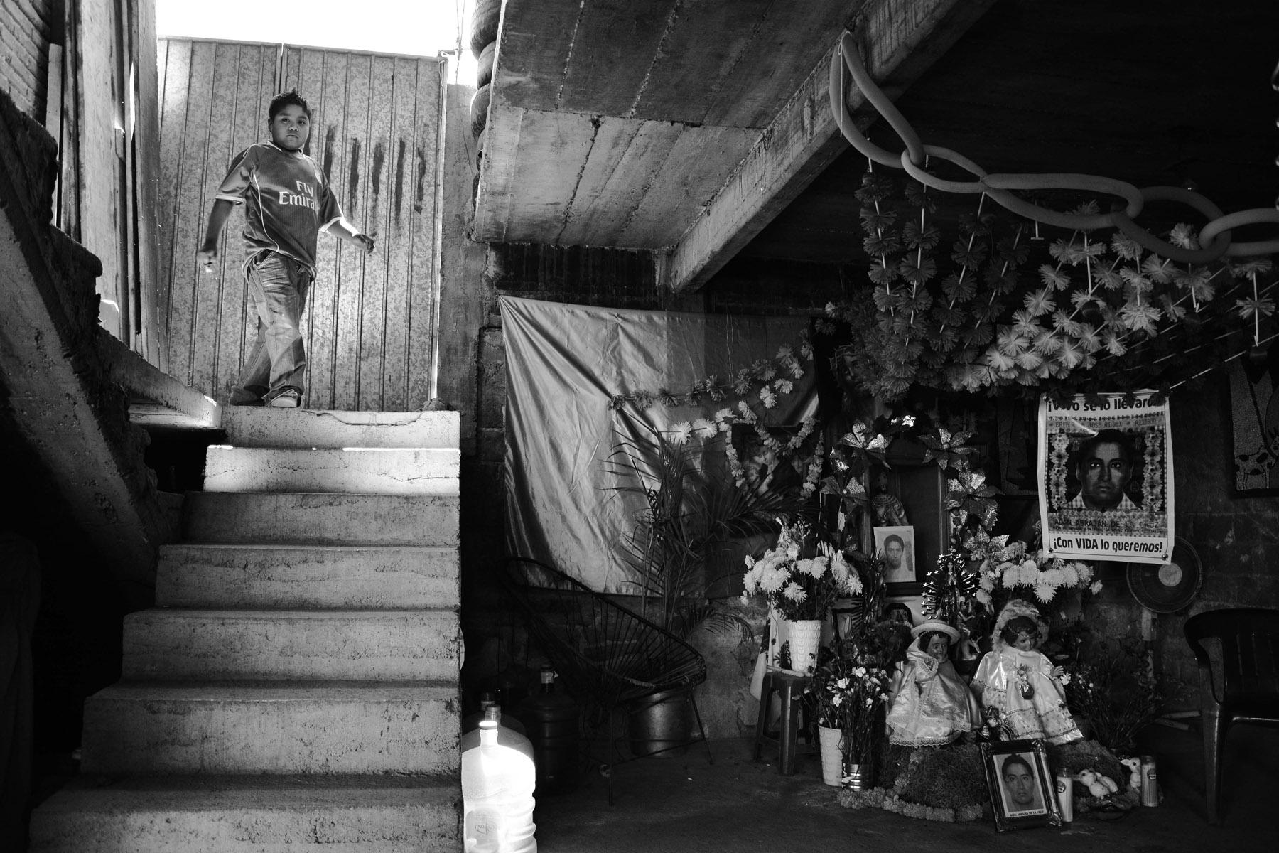 Ángel Abraján, son of Adán Abraján de la Cruz aside a memorial to remember his father inside his home in Tixtla, Guerrero. (Courtesy of Emmanuel Guillén Lozano)