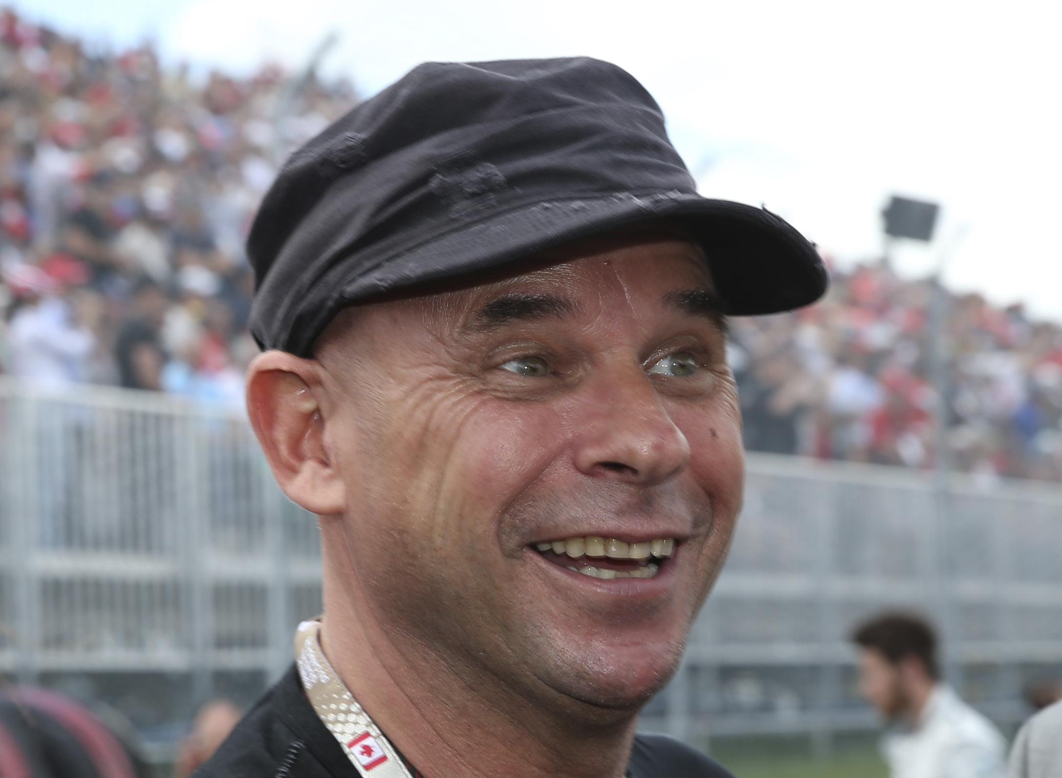 Guy Laliberté, founder of the 'Cirque du Soleil,' is a Canadian billionaire. Here he watches Formula One's Canadian Grand Prix in Montreal on June 9, 2013. (AP Photo/Luca Bruno)