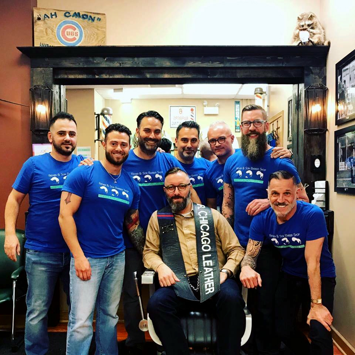Jerry Cernak (seated) poses for a photo with the staff at Father and Son barbershop. Cernak won the Mr. Chicago Leather competition in 2017. (Photo courtesy of Jerry Cernak.)