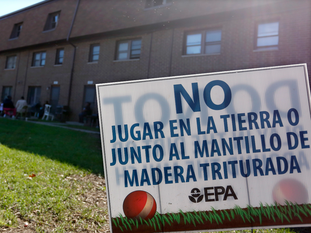A sign from the Environmental Protection Agency was posted in front of West Calumet Housing Complex houses at East Chicago, Ind. this summer after the EPA detected high levels of lead in samples of dust and dirt tracked inside homes where soil is tainted with industrial contaminants. (AP Photo/Tae-Gyun Kim)