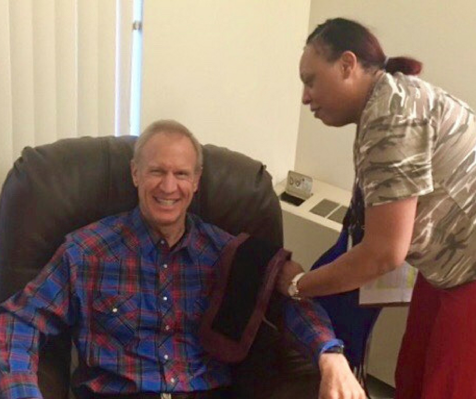 Gov. Rauner has his blood pressure taken by a staff member at the Illinois Veterans Home in Quincy during his weeklong stay there in January. (Gov. Bruce Rauner's Facebook page