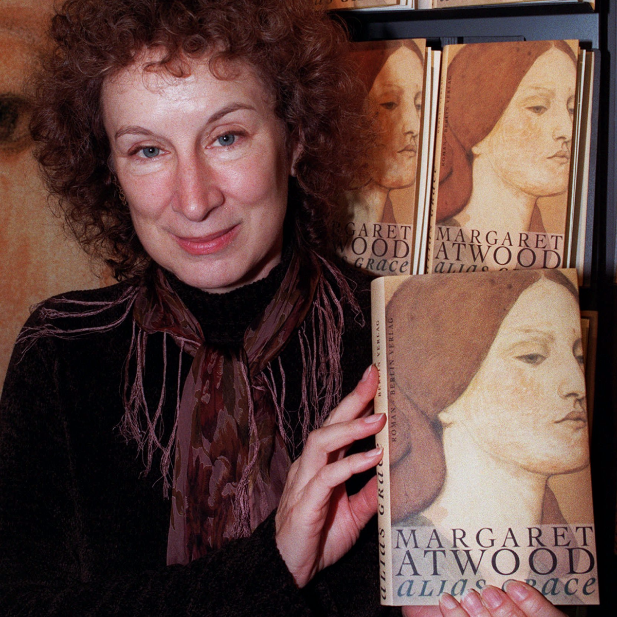 Canadian novelist Margaret Atwood showing off her new book 'Alias Grace' at the German Berlin Publishing House in Frankfurt, Germany, on October 2, 1996. (AP Photo/Heribert Proepper).