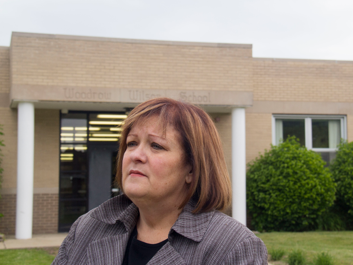 Calumet City Mayor Michelle Markiewicz Qualkinbush stands in front of Woodrow Wilson School, a school near the third apartment where Reimann was supposed to live after parole. (Paula Friedrich/WBEZ)
