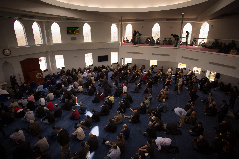 Men gather in The Prayer Center of Orland Park's main prayer hall for Jumu'ah, a Friday afternoon prayer. (Alyssa Schukar/For WBEZ)