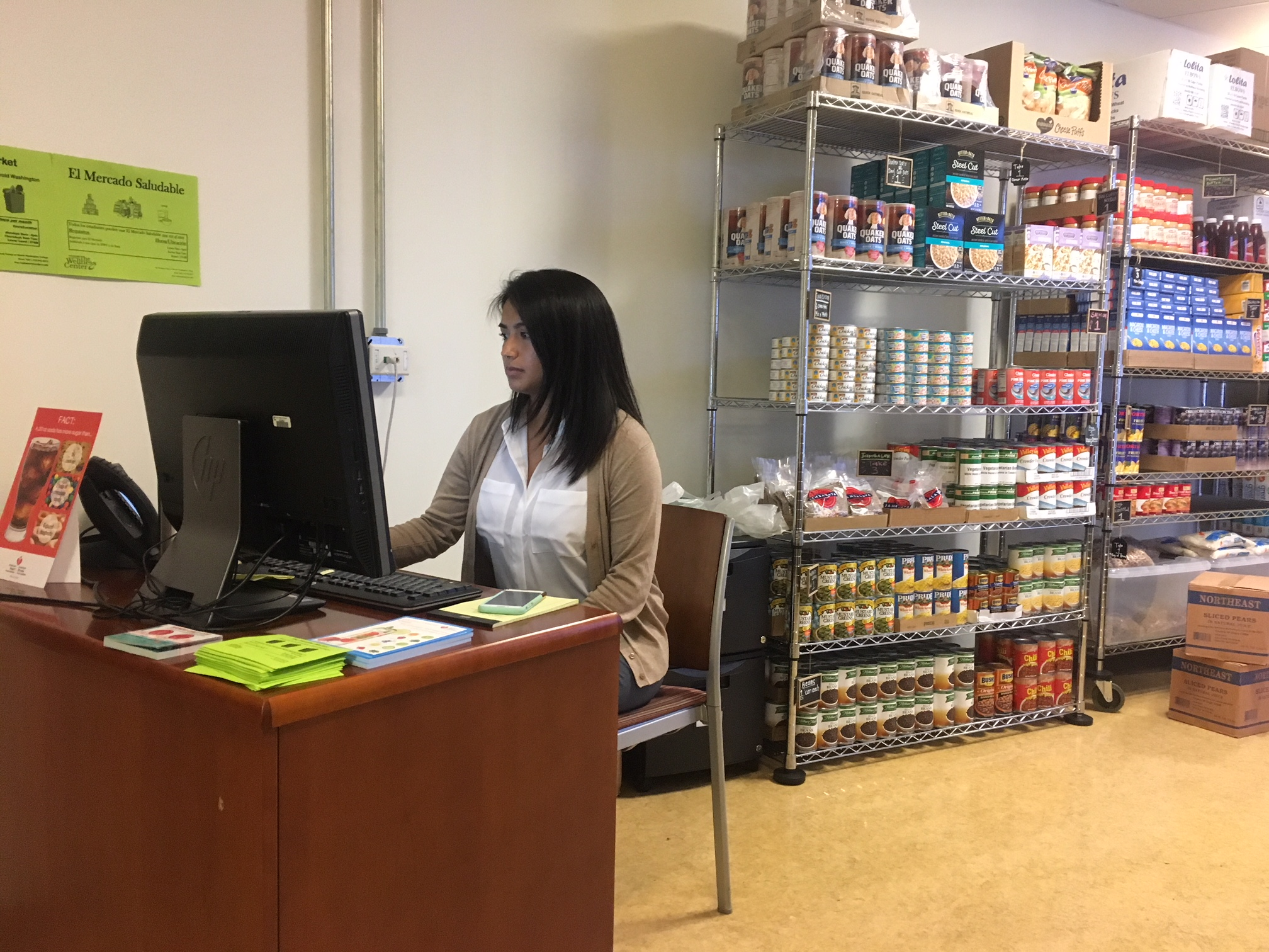 Marissa Cirillo, who works at the Harold Washington College Wellness Center, manages the food pantry recently opened for students. Students don't have to check out. Instead, a sign next to each product tells students how much they can take. (Kate McGee/WBEZ)