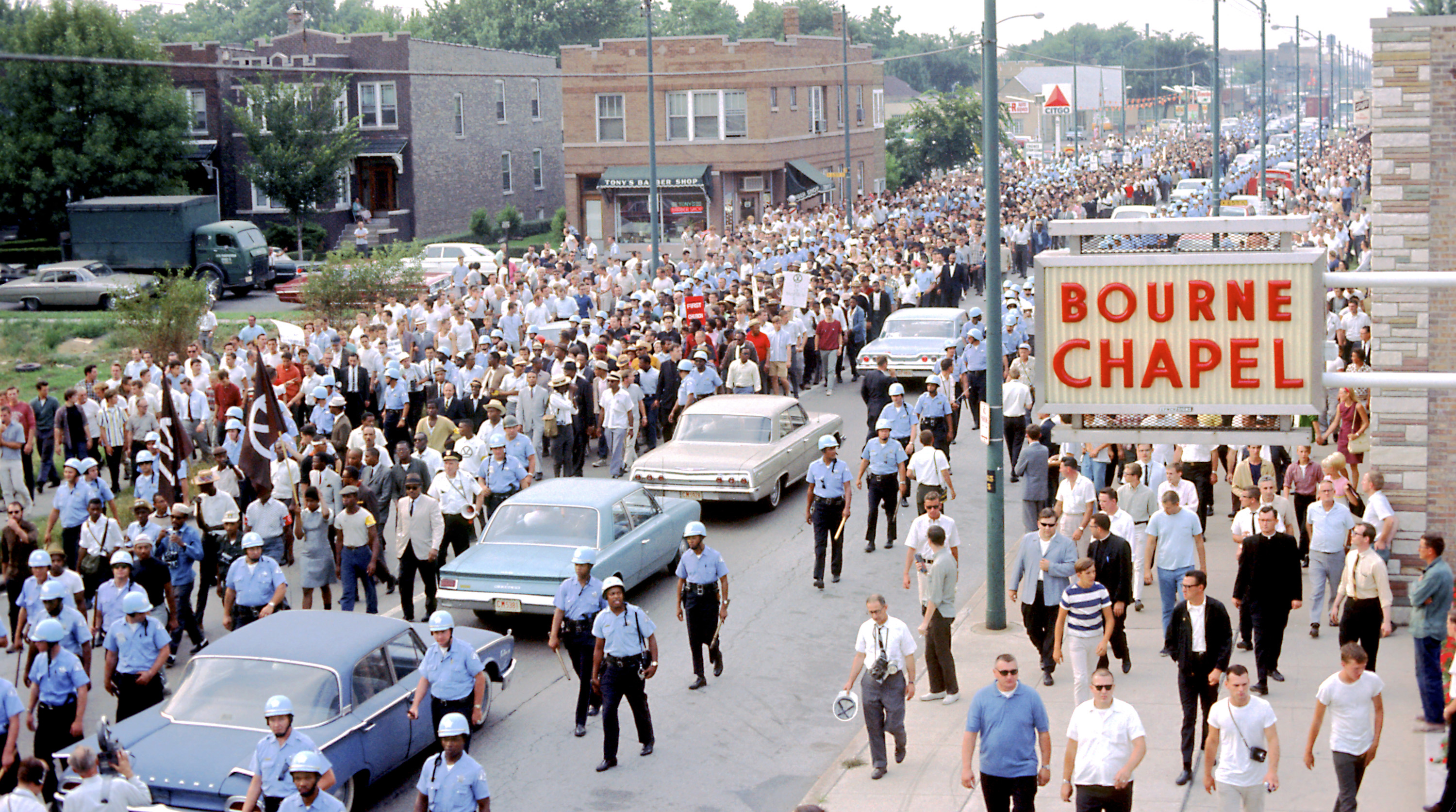 A Chicago Freedom Movement march down South Kedzie Avenue on August 5, 1966.      (Collection of the Smithsonian National Museum of African American History and Culture, Gift of Bernard J. Kleina and Susan Keleher Kleina, © Bernard J. Kleina)