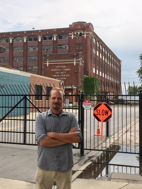 Andrew Bates stands in front of the Central Manufacturing District. Bates asked Morning Shift about the CMD for our What's That Building series.