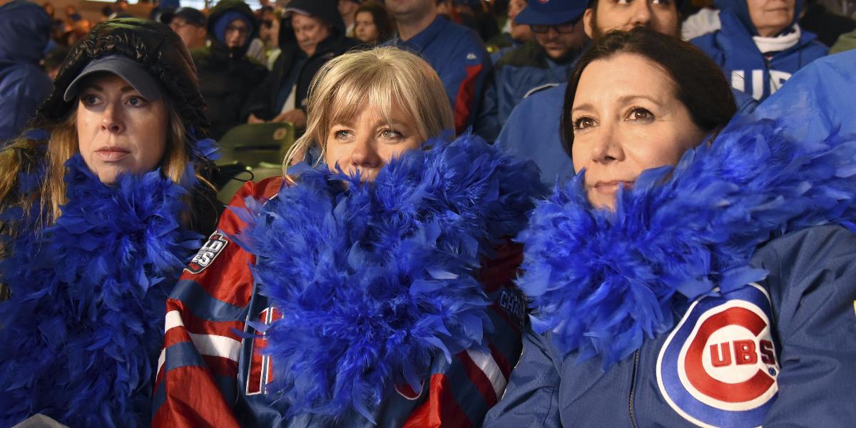 Allison Batzel, left, Jill Carroll, center, and Barbara Silvestri, right, waiting out the rain delay. (AP Photo/David Banks)