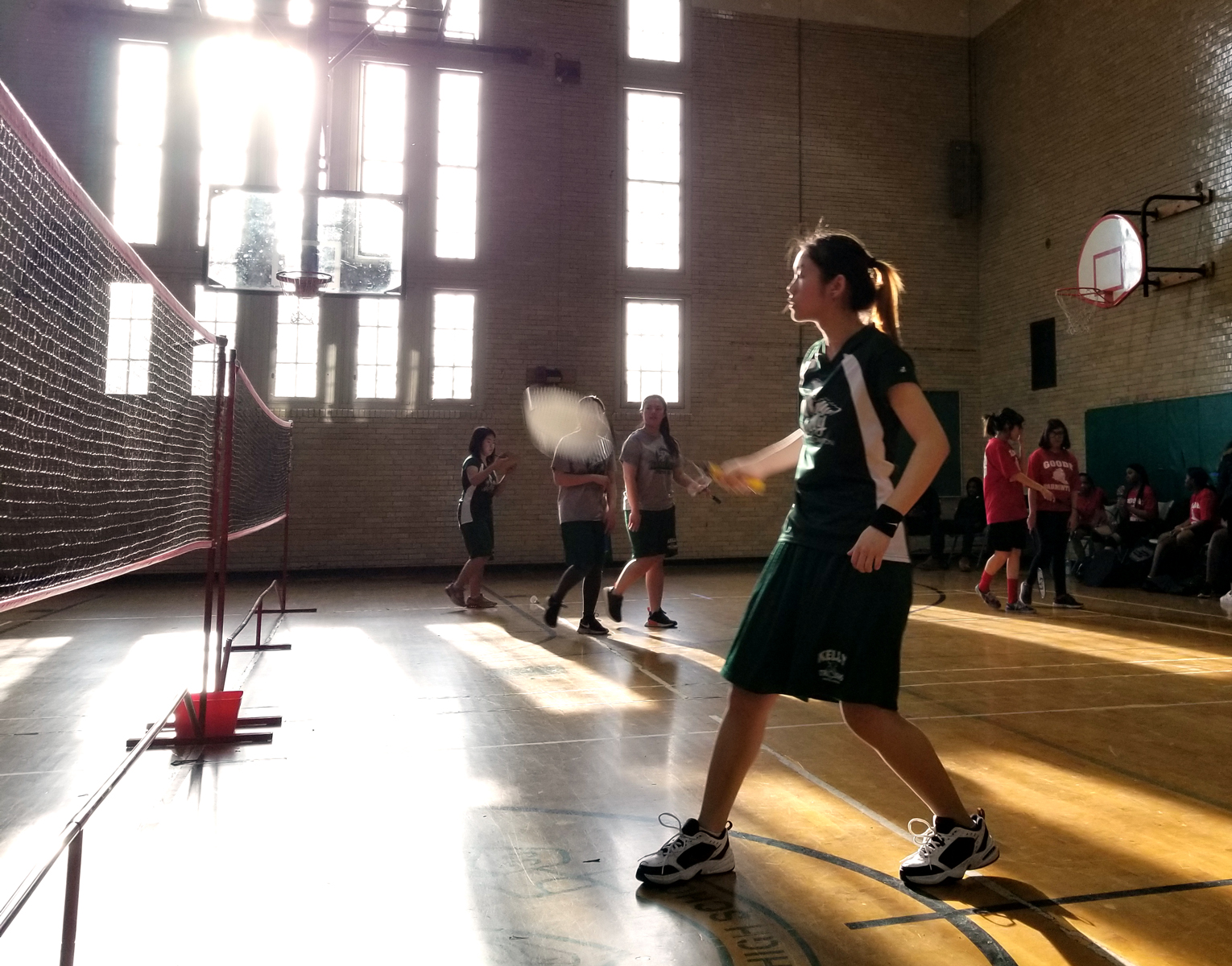 Kelly High School badminton player Ashley Liang competes against students from Goode Academy. (Linda Lutton/WBEZ)