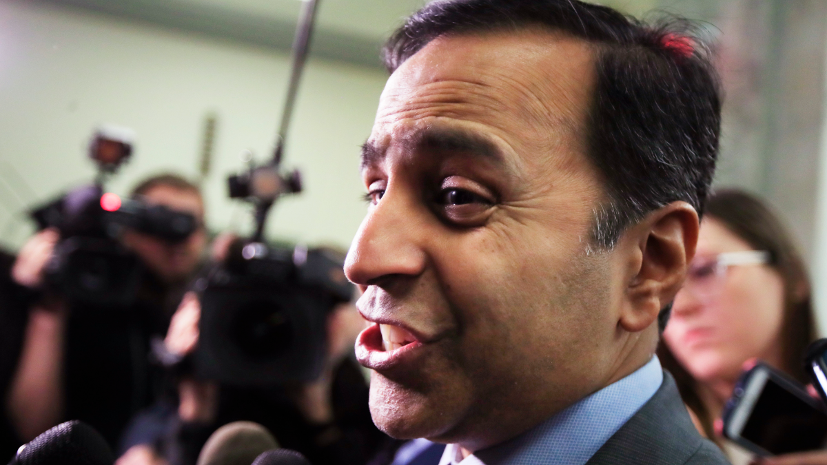 Rep. Raja Krishnamoorthi, D-Ill., speaks to reporters as he leaves a House Judiciary and Oversight Committee closed-door interview with former FBI Director James Comey on Capitol Hill in Washington, Friday, Dec. 7, 2018. (AP Photo/Manuel Balce Ceneta)
