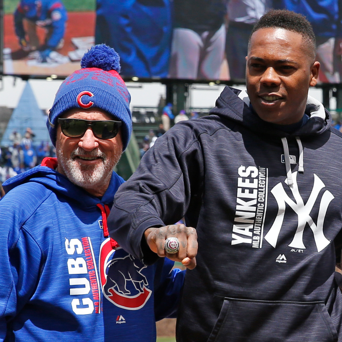 New York Yankees relief pitcher Aroldis Chapman, right, stands with Chicago Cubs manager Joe Maddon as Chapman received his 2016 World Series ring before a game at Wrigley Field on Friday, May 5, 2017. (AP Photo/Nam Y. Huh).