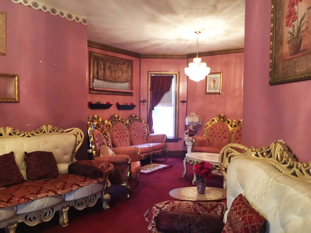 Although there's an occasional room that's themed a different color, the house's pink living room, shown here, is a standout in a house filled with bright, vivid colors. (Lakeidra Chavis/WBEZ)