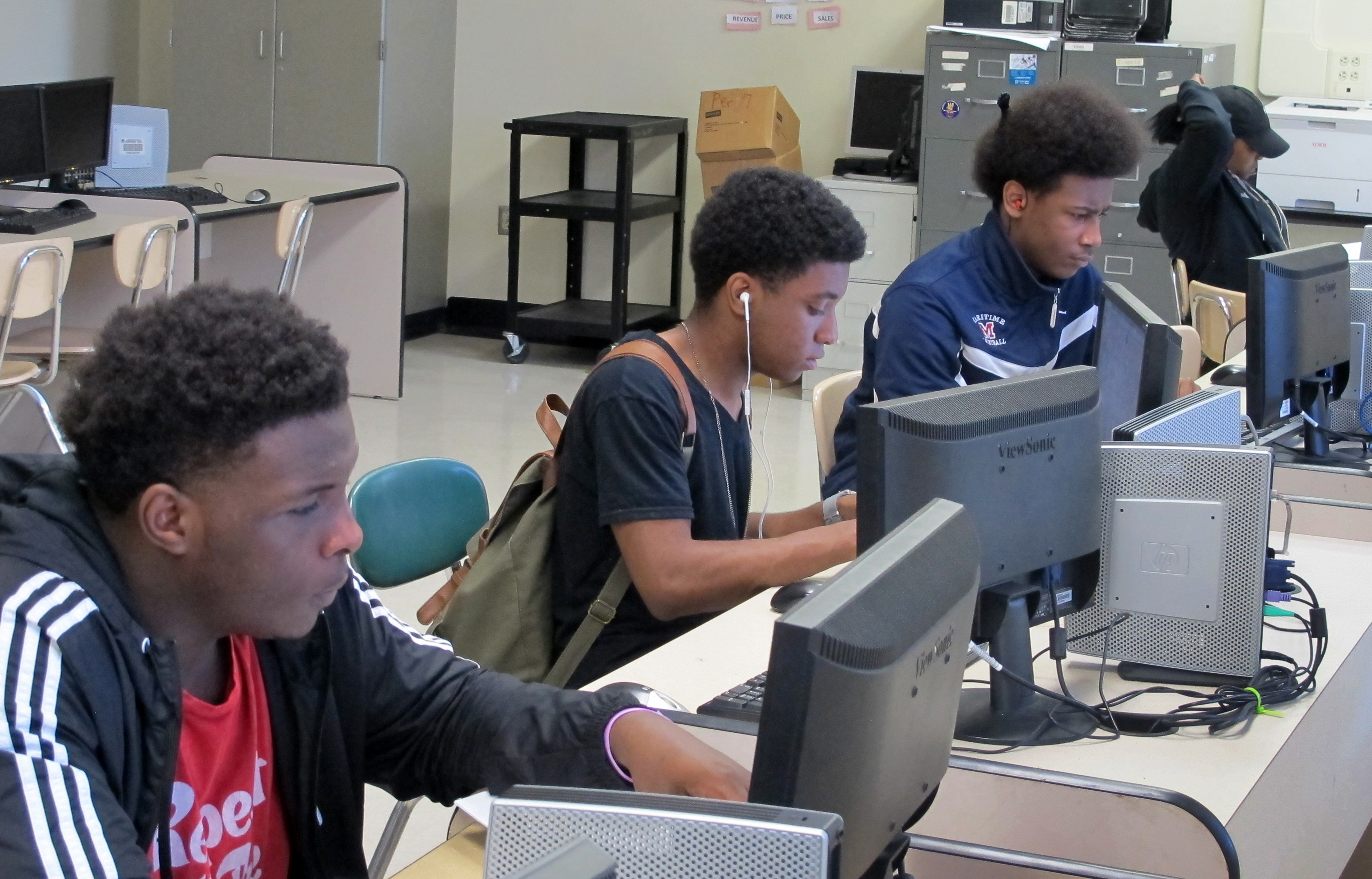 Students work at computers inside Bennett High School in Buffalo, N.Y in May 2016. The high school is being redesigned with a focus on specialty programming, such as computer science or solar energy, in order to position students to land well-paying jobs being created amid a surge in economic development in the city. (AP Photo/Carolyn Thompson).