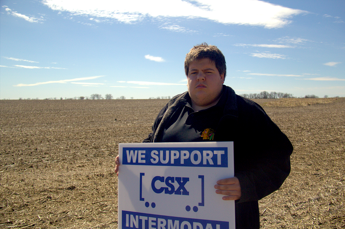 CSX supporter Erik Hoelezman stands in a field off Crete-Monee Road near where the proposed intermodal terminal would be built. (Chris Hagan/WBEZ)