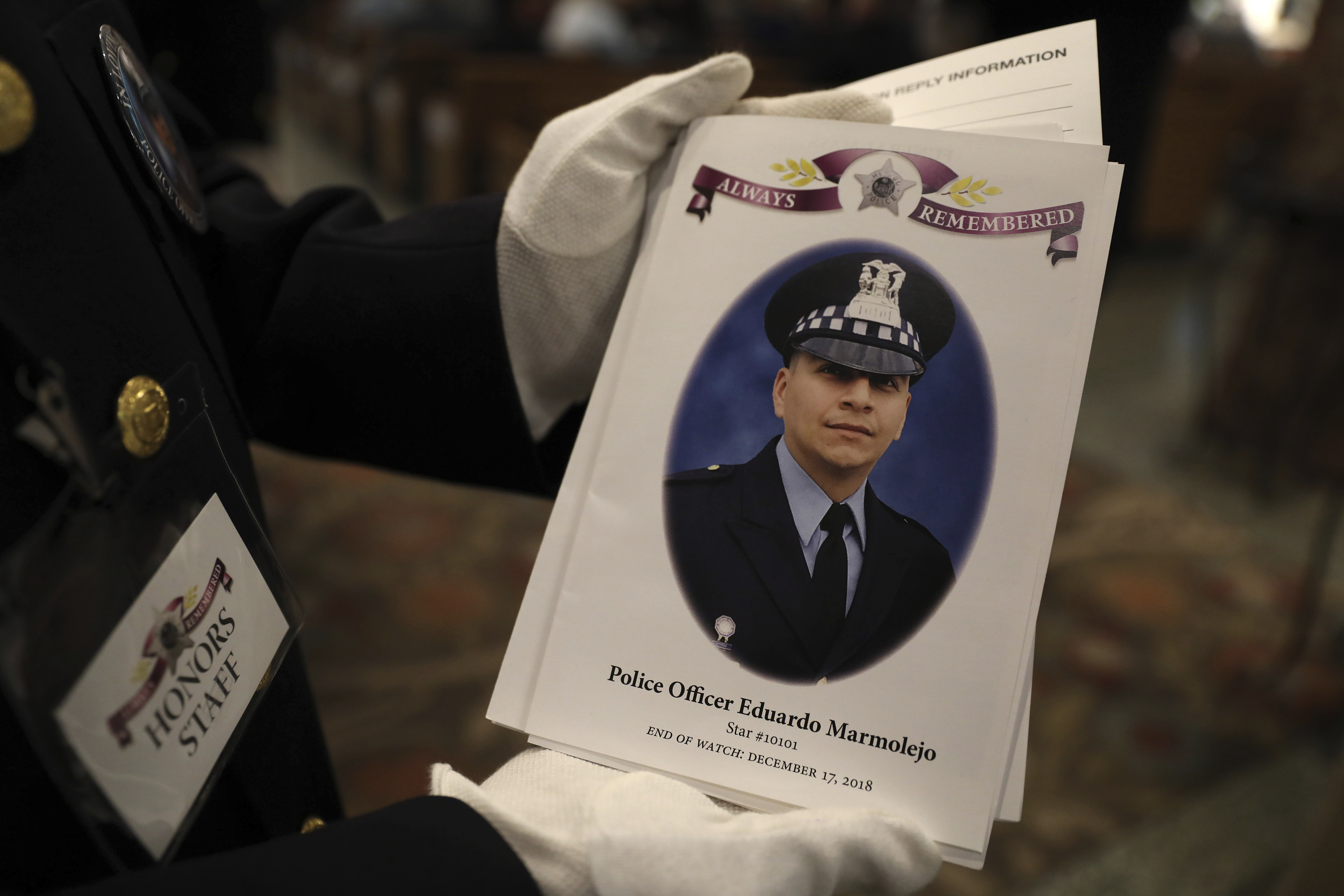 Officers prepare for the funeral for fallen Chicago police Officer Eduardo Marmolejo at St. Rita of Cascia Shrine Chapel in Chicago on Saturday, Dec. 22, 2018. (Abel Uribe/Chicago Tribune via AP, Pool)