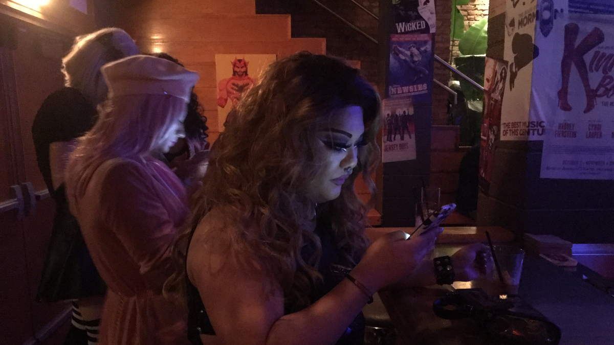 Drag queen Joonage A Trois waits to perform at a bar in Chicago's Boystown. She said she is concerned about homophobia during the World Series. (Hunter Clauss/WBEZ)