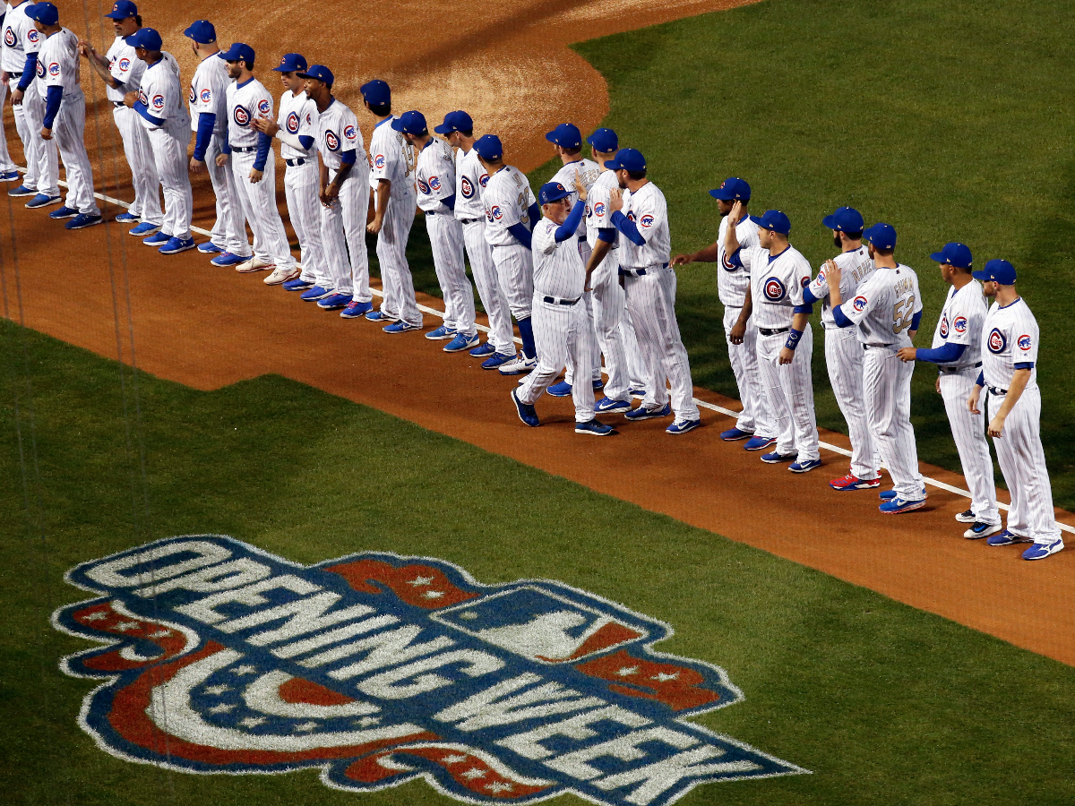 Chicago Cubs manager Joe Maddon, center, greets his team during home opening ceremonies. (AP Photo/Nam Y. Huh)