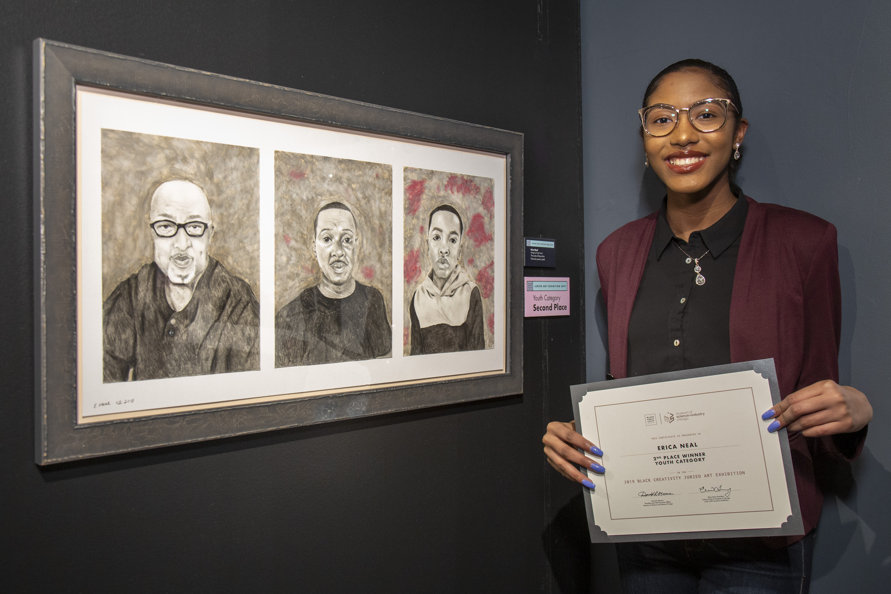 """Youth artist Erica Neal, of Bolingbrook High School, won second place in the youth category this year. MSI arts and creative manager Tiffany Malone explained in January that Neal's piece, """"The Cycle of Masculinity,"""" represents different generations of a family."""