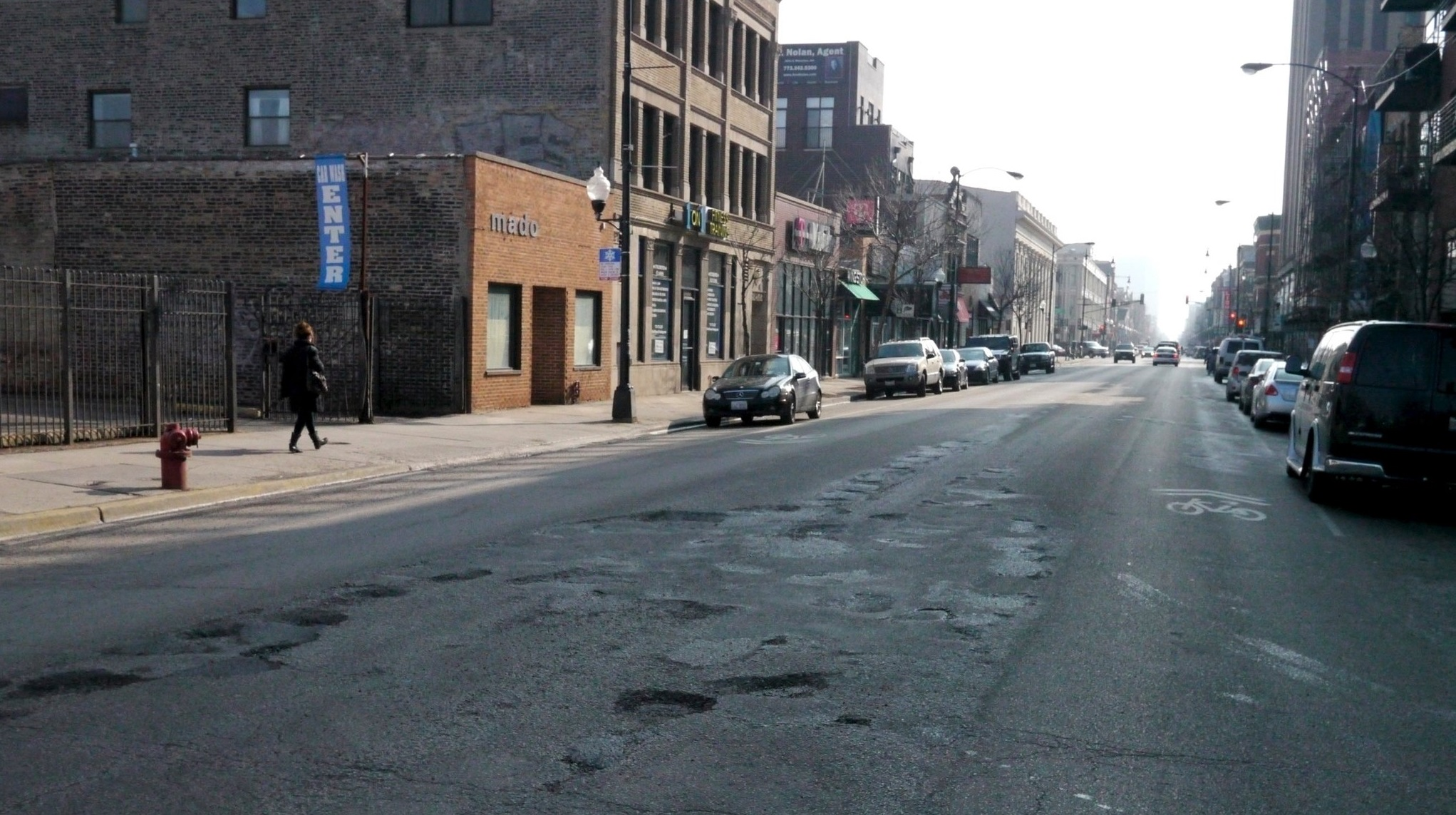 Potholes pepper a stretch of Milwaukee Ave. (Courtesy Steven Vance)