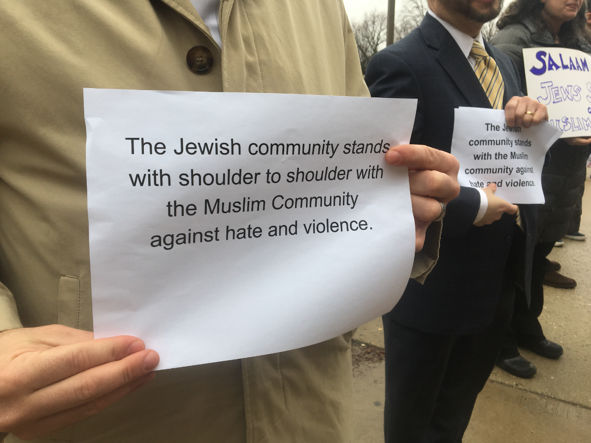 Representatives from Jewish organizations express their sympathies and solidarity with worshippers leaving Friday prayer services at the Muslim Community Center in Chicago's Morton Grove campus on Friday.