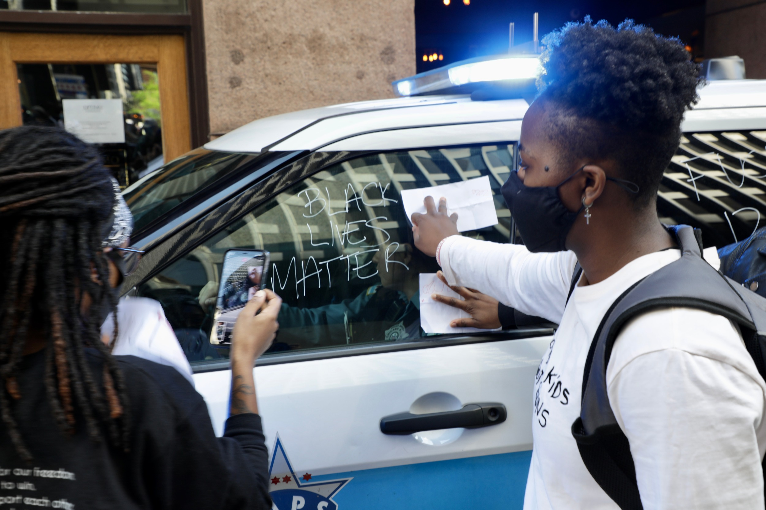 People up on cop car