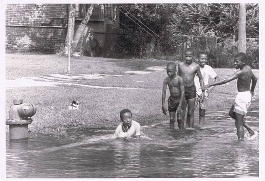 Boys in Chicago wade in water from a fire hydrant in 1988. Photo courtesy of the Chicago Defender/Obsidian Collection.