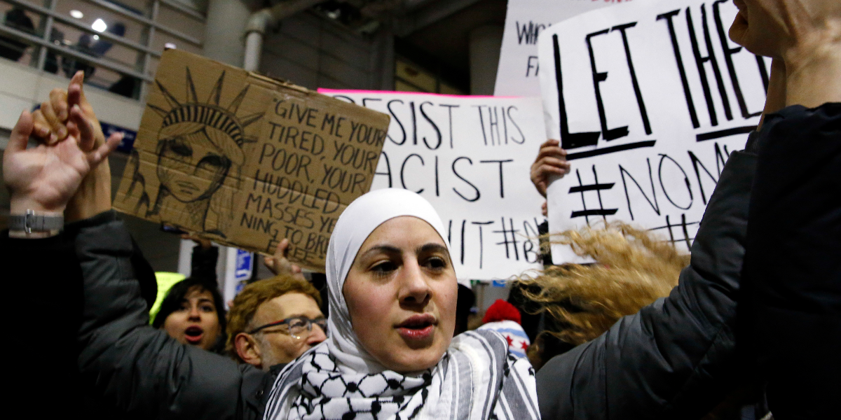 Demonstrators converge outside Terminal 5 of O'Hare airport Sunday, Jan. 29, 2017, in Chicago. President Donald Trump signed an executive order suspending all immigration from countries with terrorism concerns for 90 days. Countries included in the ban are Iraq, Syria, Iran, Sudan, Libya, Somalia and Yemen, which are all Muslim-majority nations. (AP Photo/Nam Y. Huh)