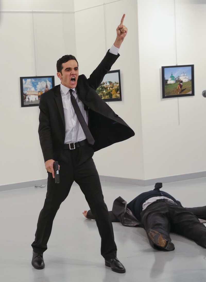 World Press Photo awarded its top honor to Burhan Ozbilici's image of a man with a gun standing over the slain Russian ambassador in Ankara in December. (Burhan Ozbilici/AP)