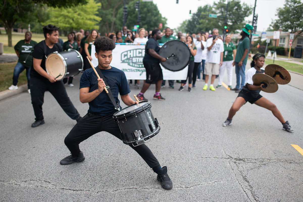 The Urban Core Drumline from the Elite Edge Dance Academy marches in the Chicago State University back to school parade as it moves north along King Drive. (Marc C. Monaghan for WBEZ)