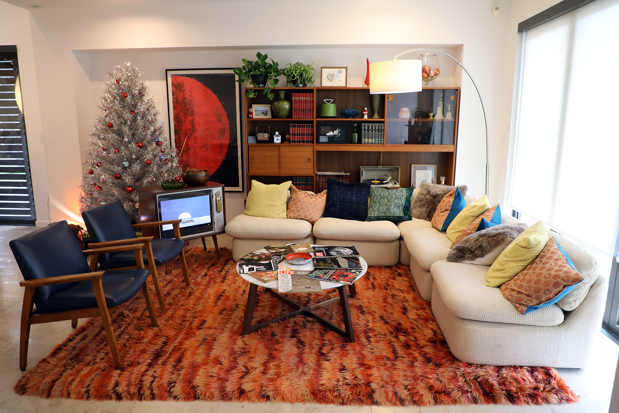 Moon Room 1968 is a replica of a midcentury living room, complete with a retro television set. (Arionne Nettles/WBEZ)