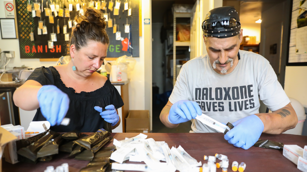 Maya Doe-Simkins and Stephan Kamenicky of The Chicago Recovery Alliance prepare naloxone rescue kits at their Chicago headquarters on Aug. 8, 2019.