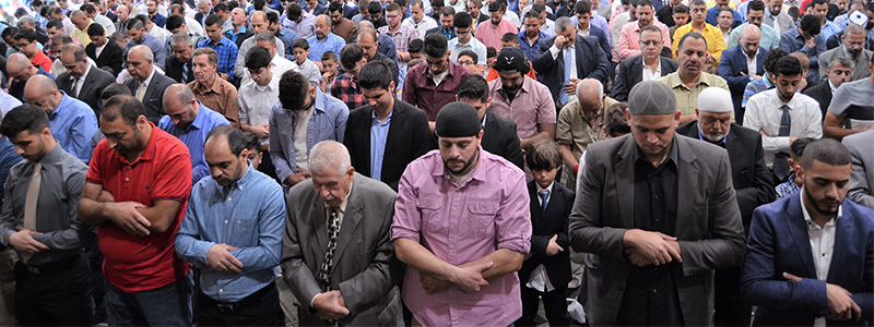 Predominantly Arab Muslim attendees participate in the Eid Al Adha festival prayer at the Tinley Park convention center in the southwest suburbs of Chicago. (Courtesy Kifah Mustapha)