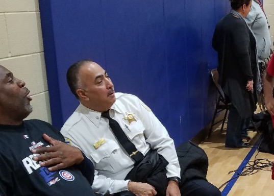 Ogden District police Cmdr. James Sanchez (right) watches a basketball game at the Chicago Westside Christian School on Jan. 25, 2017. (Twitter/Chicago CAPS 10)