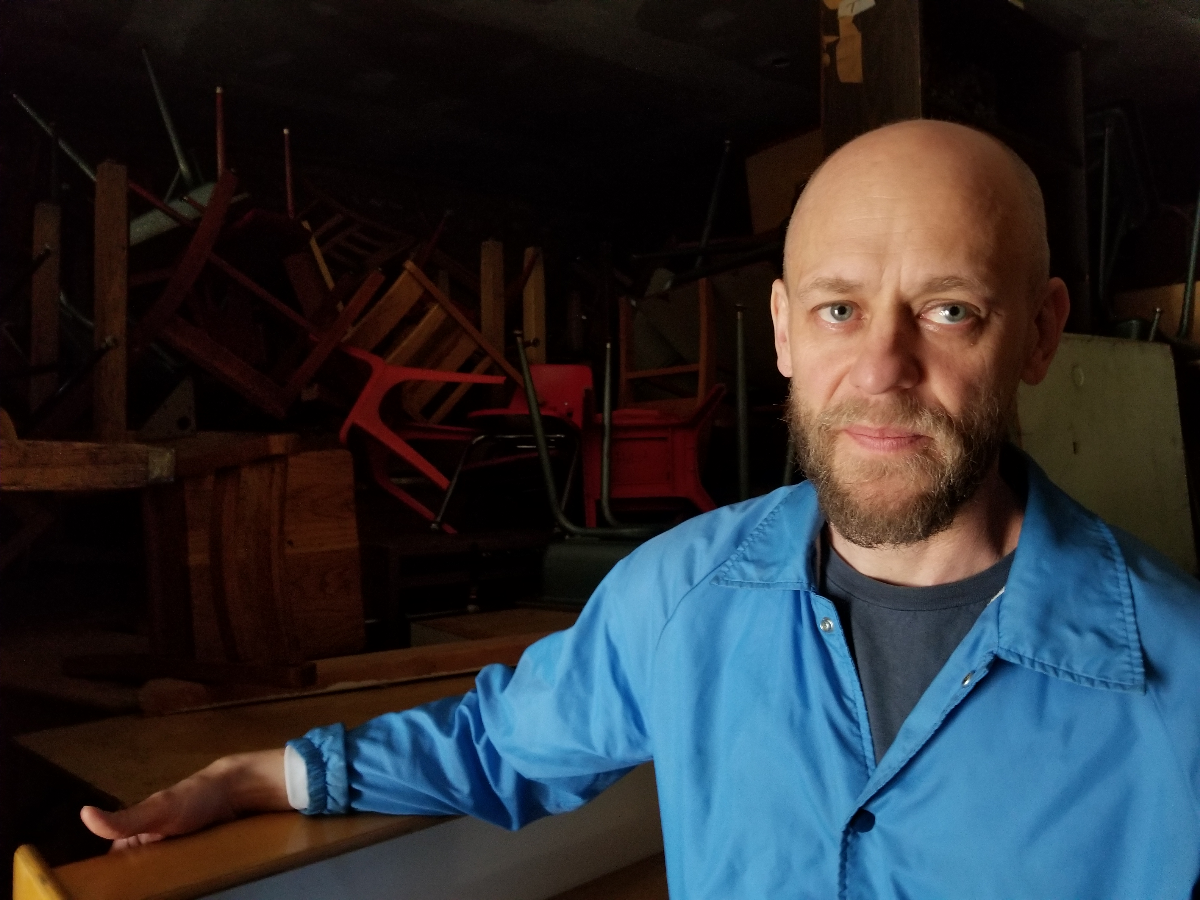 John Preus at his storage space in May 2018. (Linda Lutton/WBEZ)