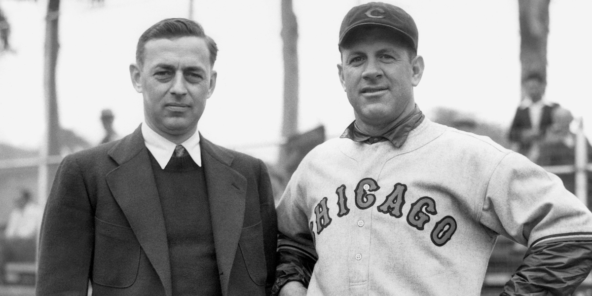 Philip K. Wrigley, left, owner of the Chicago Cubs, and Charles Grimm, manager and first baseman, photographed as they talked over the Cubs' chances at the Catalina training camp in California on March 10, 1934. (AP Photo)