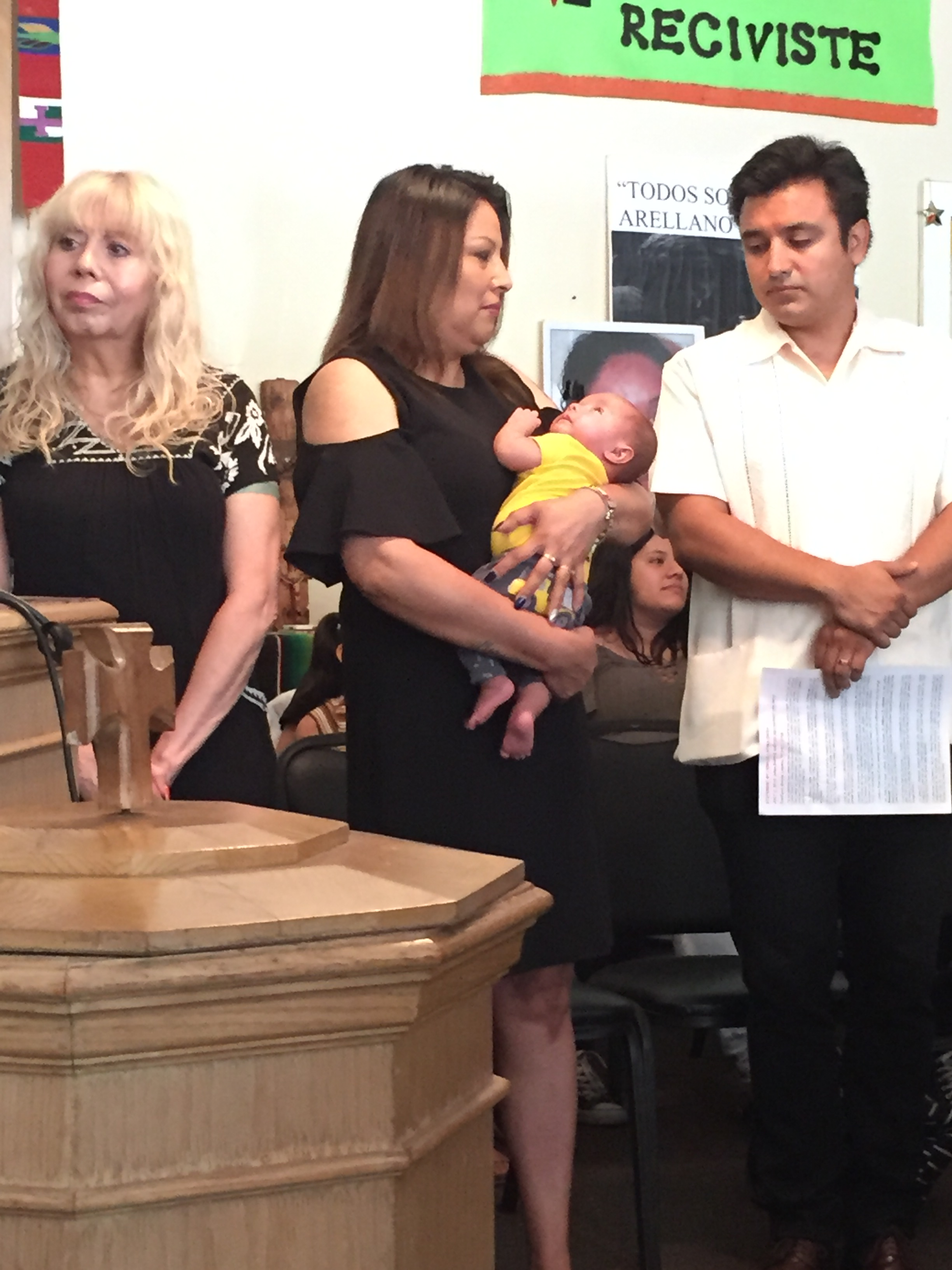 Francisca Lino holds her grandson, Diego, during a press conference inside the Adalberto United Methodist Church.