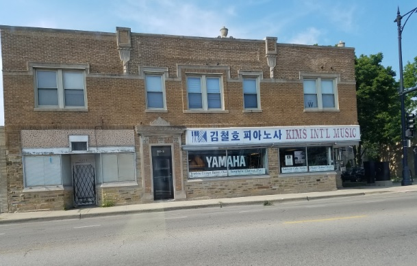 Although many Korean businesses have left Lawrence Avenue, others are hanging with fading signs.      (WBEZ/Monica Eng)
