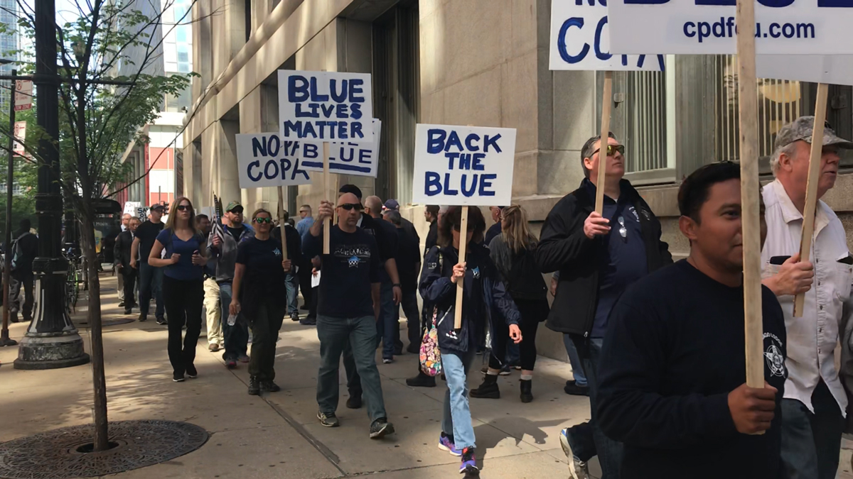 Members of the Fraternal Order of Police, Lodge 7 protest ahead of a City Council meeting in May. (Claudia Morell/WBEZ)